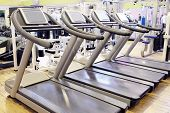 foto of treadmill  - Set of treadmills staying in line in the gym - JPG