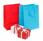 Shopping bags and gift boxes isolated on white background