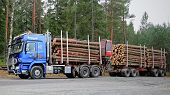 Blue Sisu Polar Timber Truck With Trailers Full Of Spruce Logs