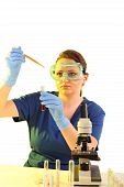 Female Researcher Working With Chemicals