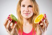 Raw fruits comparison, kiwi and orange
