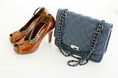 Ladies Leather Blue Handbag And Brown Color Of High Heel Shoes Isolated On White Background