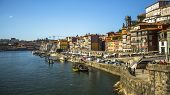 PORTO, PORTUGAL - FEB 17, 2015: Ribeira, traditional boats at Douro river in Old Town. In 1996, UNESCO recognised Old Town of Porto as a World Heritage Site.
