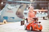 pic of girl toy  - Cute little girl with chestnut colored hair and short hair - JPG