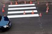 stock photo of pedestrian crossing  - making of a new pedestrian crossing on the road - JPG