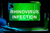Computer with words Rhinovirus infection.