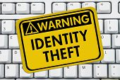 foto of theft  - Identity Theft Warning Sign A yellow sign with the words Identity Theft on a keyboard - JPG