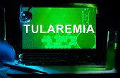 Computer with words Tularemia.