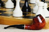stock photo of tobacco-pipe  - Chess middle game and tobacco pipe of one of the players - JPG