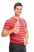 Vertical shot of a young man drinking water from a bottle isolated on white background