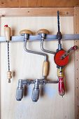 four old fashioned drills in closet