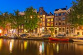 image of gable-roof  - Night city view of Amsterdam canal Herengracht, typical dutch houses and boats, Holland, Netherlands. ** Note: Visible grain at 100%, best at smaller sizes - JPG