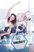 foto of senior class  - The word energy and class stretching hands at yoga class against hexagon - JPG