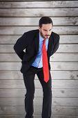 Businessman against wooden planks