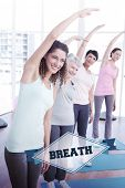 The word breath and class stretching hands at yoga class against badge