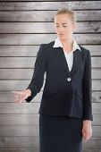 Businesswoman pointing somewhere against wooden planks