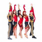 dancer team wearing in traditional flamenco dresses