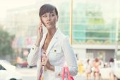 Yong Lady In White Jacket Have Phone Conversation On The Street
