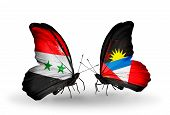 Two Butterflies With Flags On Wings As Symbol Of Relations Syria And Antigua And Barbuda
