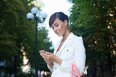 Beautiful Model In White Jacket  Dealing Phone Number On The Street