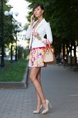 Sexy Young Business Woman Talking On Phone On The Street.  Flowered White Dress .beige Leather Handb