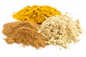 piles of three healthy spices -turmeric, ginger and cinnamon