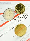 Euro coins on bank statement