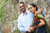 foto of indian culture  - Happy Smiling indian adult people couple outdoors - JPG