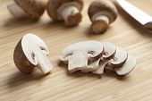 Fresh chestnut mushrooms slices on the cutting board
