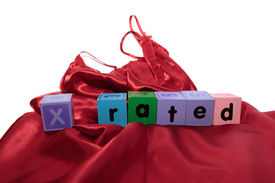 stock photo of x-rated  - x rated written with blocks on a silk nightie against white background - JPG