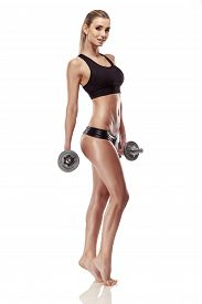 picture of tanga  - Nice sexy woman doing workout with dumbbell isolated over white background - JPG