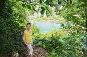 picture of emerald  - young woman traveling in mountains - JPG