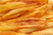 stock photo of french fries  - Heap of french fries fried in oil deep fried unhealthy and caloric food - JPG