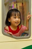 picture of bus driver  - Little Asain Chinese Bus Driver at indoor playground - JPG
