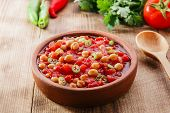 picture of chickpea  - cooked chickpeas with tomatoes in a bowl - JPG