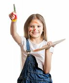 picture of paint palette  - Portrait of cute smiling girl with painted face posing with paint palette - JPG