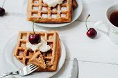 stock photo of whipping  - Breakfast with wholegrain brussels waffles and whipped cream - JPG
