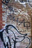 Graffiti On Old Grunge Brick Wall