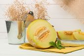pic of honeydew melon  - Juicy honeydew melon on a wooden table background - JPG