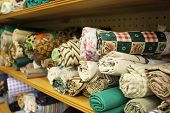 picture of quilt  - Small rolls of colorful fabric for a quilt - JPG
