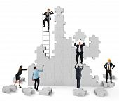 stock photo of collaboration  - Teamwork collaborates and cooperates for the construction - JPG