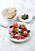 stock photo of kalamata olives  - Mediterranean salad with feta and kalamata olives - JPG
