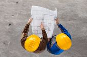 pic of angle  - High Angle View Of Two Architects Discussing Blueprint - JPG