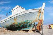 picture of veterans  - Old veteran ruined fishing boat in beach shore on Greek Kos island Mastihari sea bay - JPG