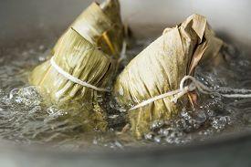 stock photo of chinese wok  - Zongzi boiling in a wok - JPG
