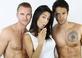 stock photo of swingers  - Two men and one woman posing over a white background - JPG