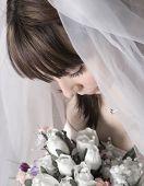 Bridal Portrait Looking Down At Bouquet