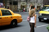 Woman Hailing New York Cab / Taxi