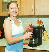 Woman Making Coffee Using Espresso Machine