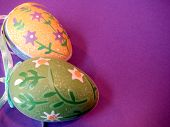 stock photo of ostara  - Two decoratedfestive eggs with place on the sie for designer - JPG